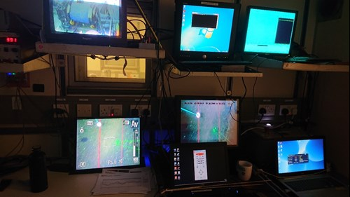 The monitor screens used for observing live imagery feed of the drop frame in relation to the seabed